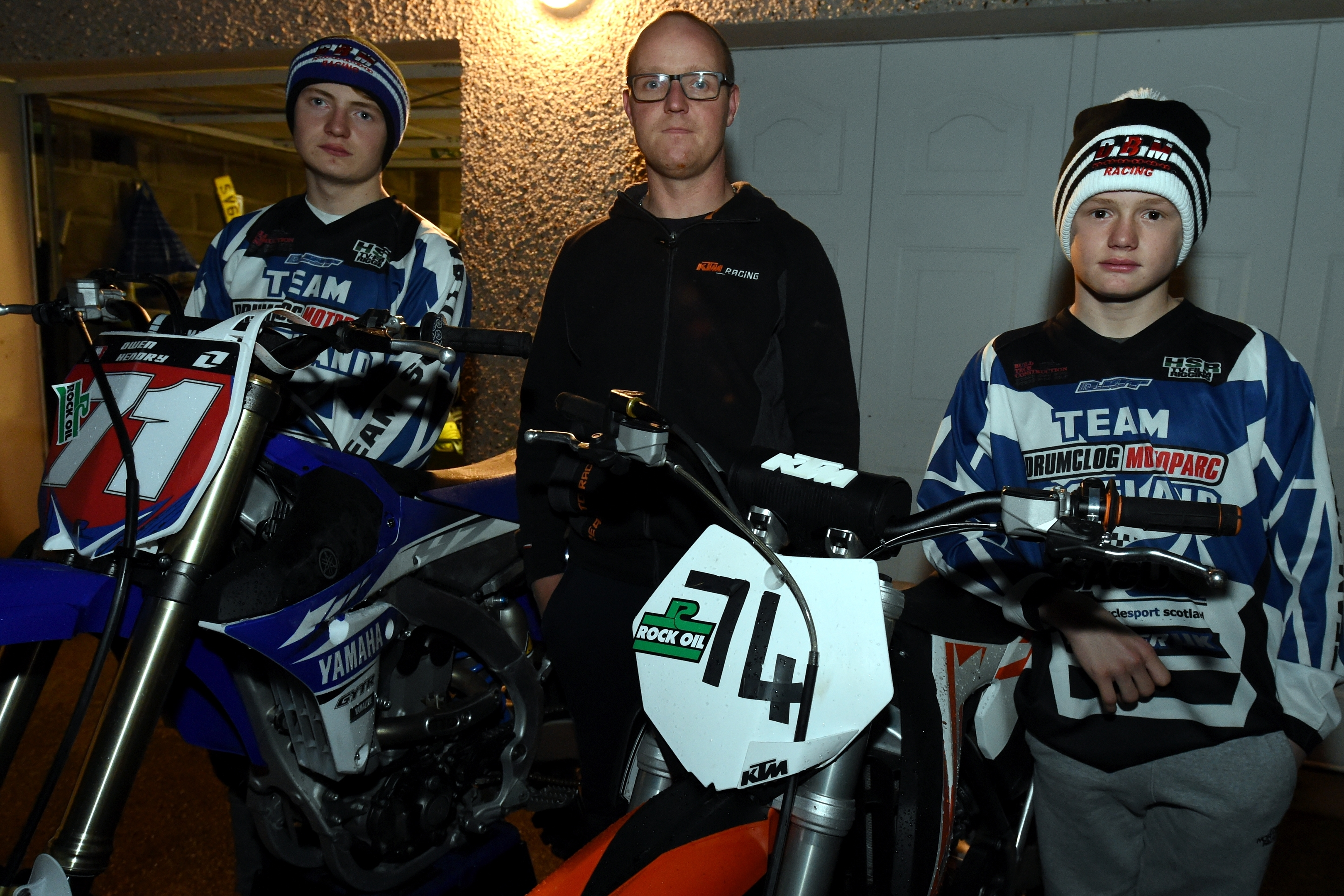 Barry Hendry flanked by his sons, Owen, left and Logan at Kintore after some of their bikes were stolen.  Picture by Jim Irvine