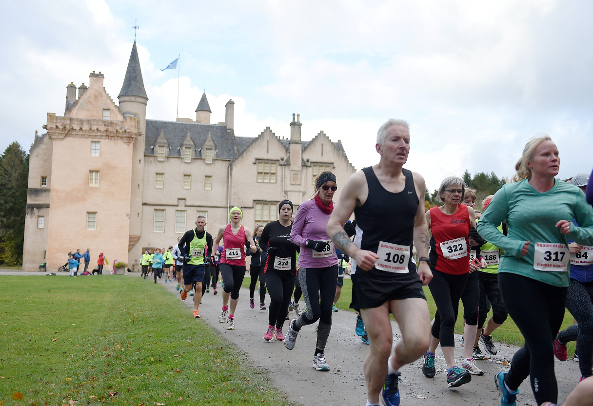 Runners settle into their rhythm after the start at Brodie Castle.