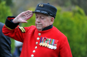 Chelsea pensioner and former Keith man, James George salutes after laying a wreath, at the Keith Remembrance Day Service at the War Memorial in Church Road. Picture by Gordon Lennox