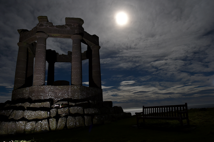 The full moon shines upon the Stonehaven's War Memorial standing on top of the Black Hill Picture by COLIN RENNIE