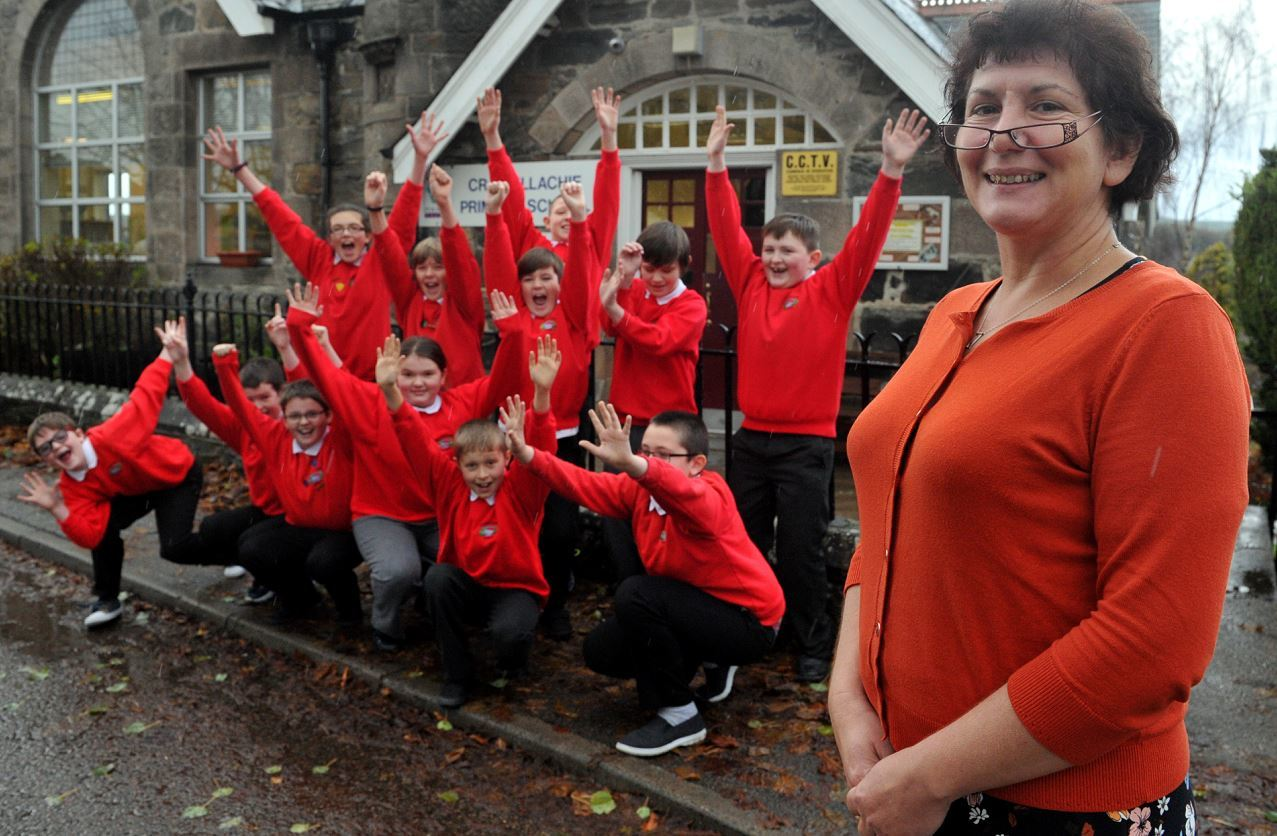 Craigellachie Primary School. Head teacher, Shiobhan Woolgar and her P7 house captains celebrate the good inspection report.