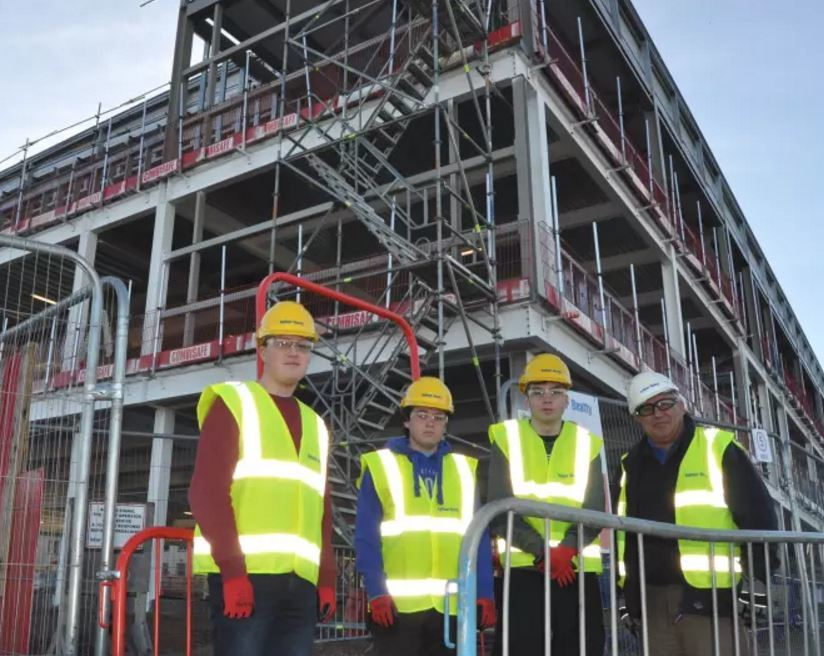Elgin High pupils Craig Alexander, Jake Innes and Rowan Duncan with site manager Iain Mackie
