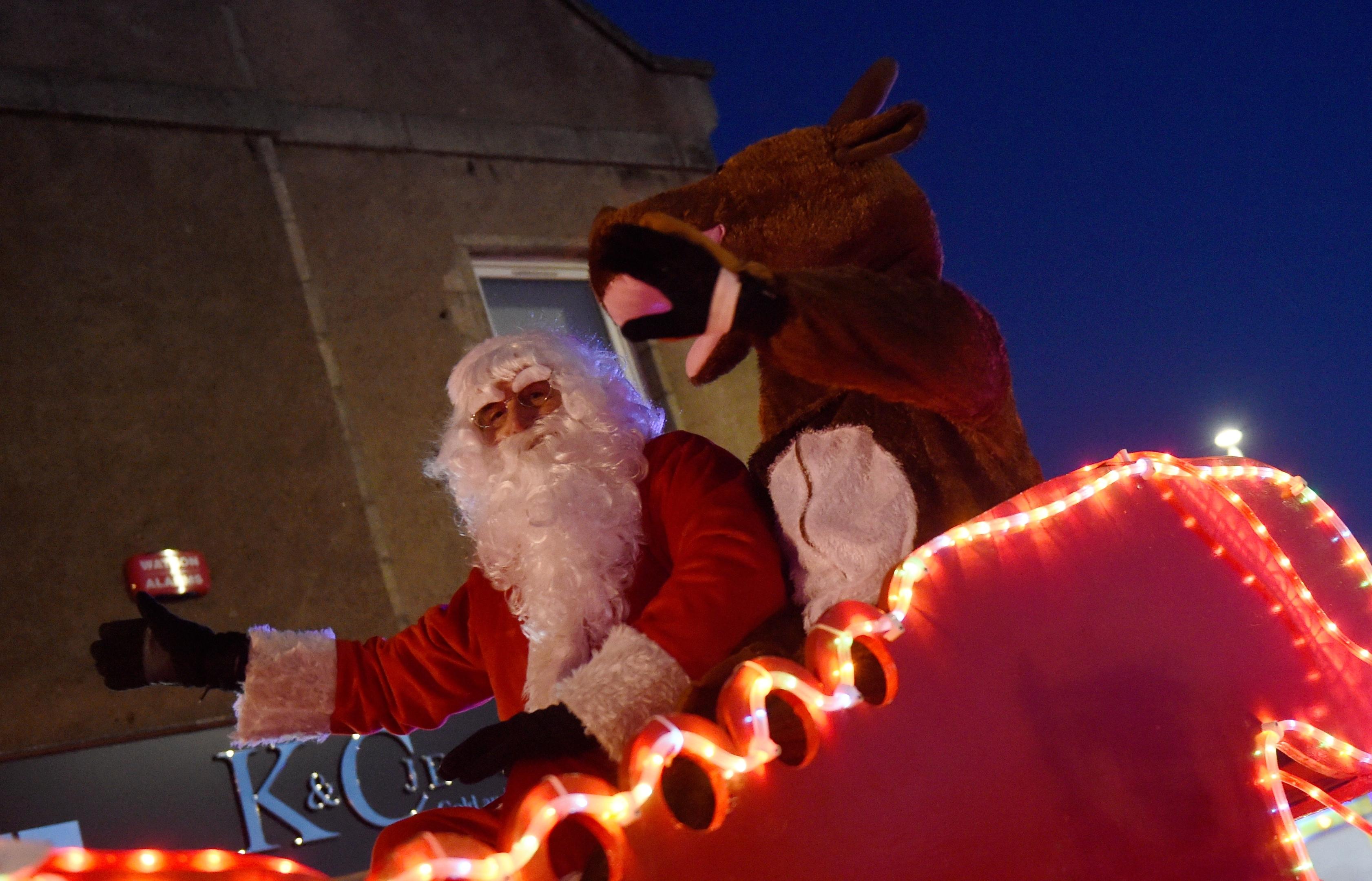 Santa and Rudolph in their sleigh as part of the parade through Ellon.