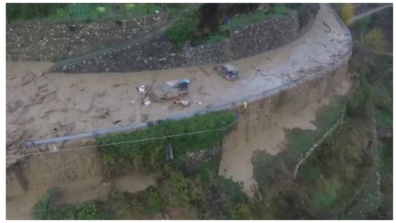 The footage features the river of rubble flowing through Ligurian village, Rezzo.