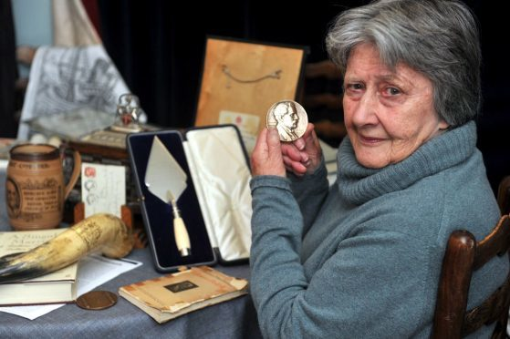 Ramsay Macdonald's granddaughter, Iona Kielhorn, in his old home in Lossiemouth, with some of the mementos, which will be included in the exhibition in Lossiemouth Town Hall. Picture by Gordon Lennox
