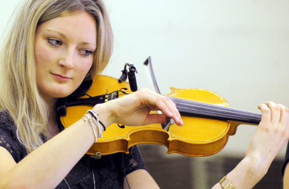 Mhairi Marwick teaches the fiddle to 26 children at her family's farm near Mosstodloch.