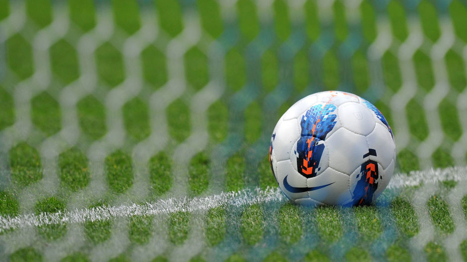 Generic photograph of a football and goal.