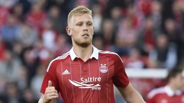 Jayden Stockley came  off the bench to score Aberdeen's third.