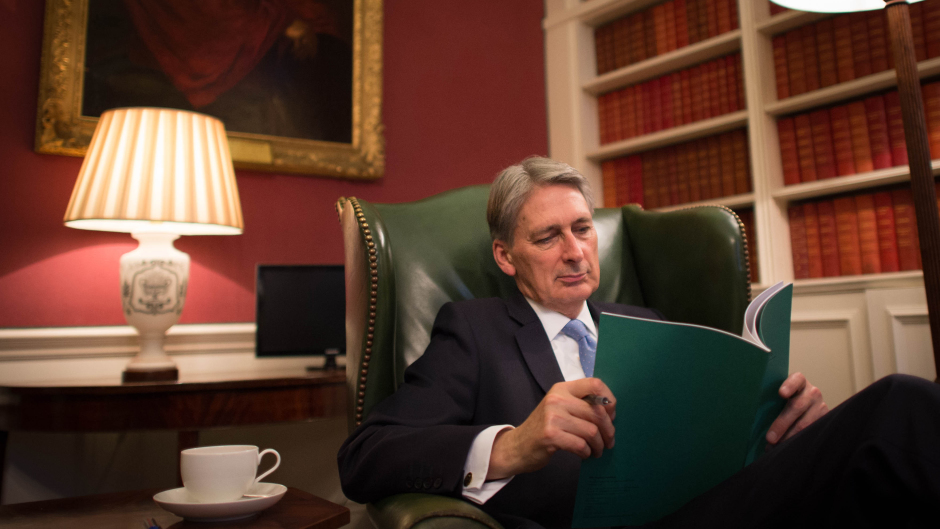 Chancellor of the Exchequer Philip Hammond reads through his Autumn Statement in his office in 11 Downing Street