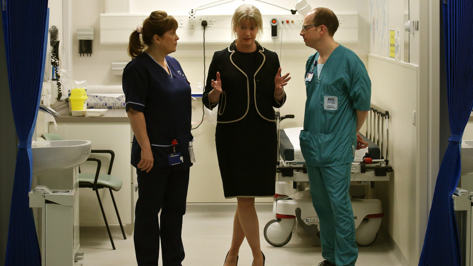 Shona Robison (centre) said a new outpatient strategy would 'ensure people get seen by the most appropriate health professional'