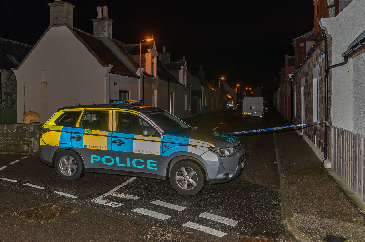 Police taped off houses on Victoria Street in Portknockie following reports of a stabbing.