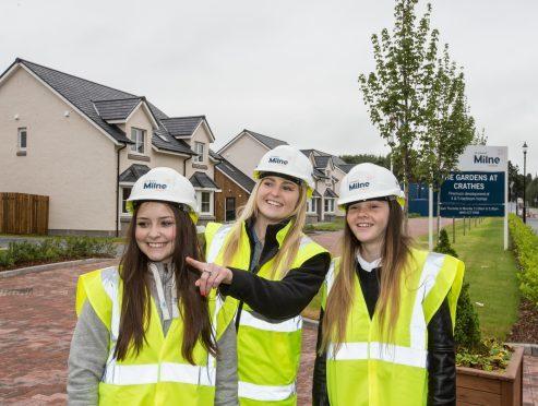 Stewart Milne Homes trainee quantity surveyor Abbie Duthie (centre) shows pupils round a development