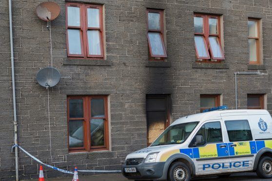 The cordoned off flat in Wick's Huddart Street, where a fire led to a mans arrest.