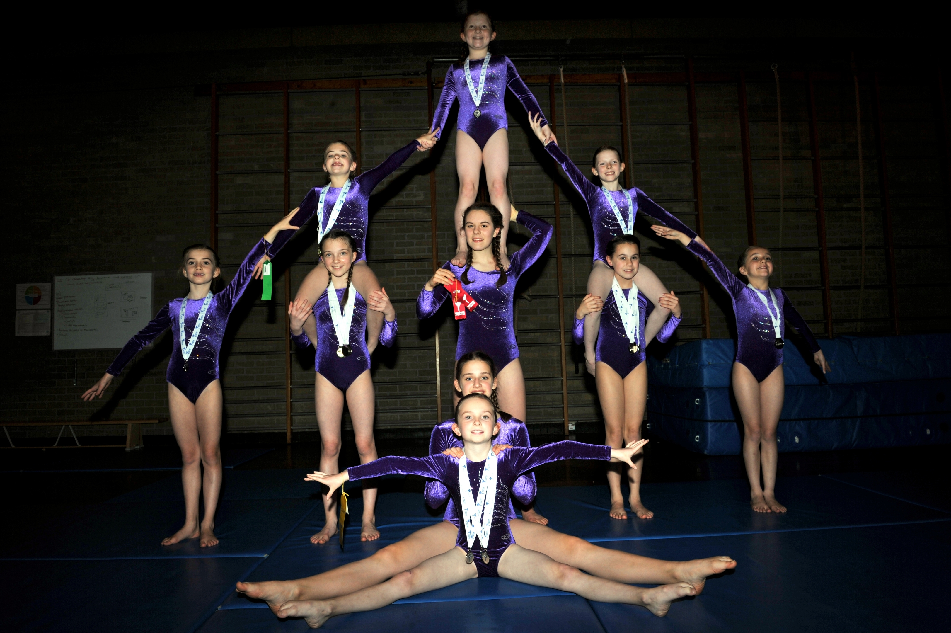 Members of the Forres Gymnastics Club pose during training at their gymnasium, after winning medals in their last competition Picture by Gordon Lennox