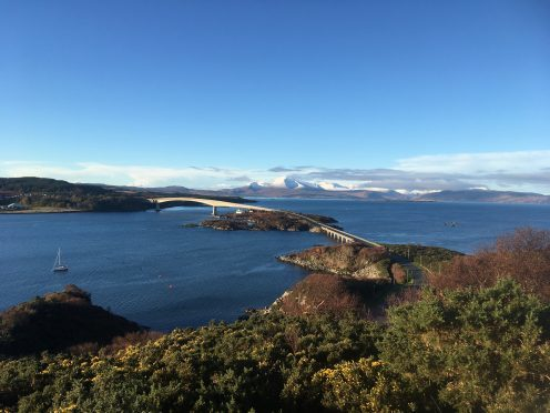 The view across the Skye Bridge to the snowy Cuillin mountain range.