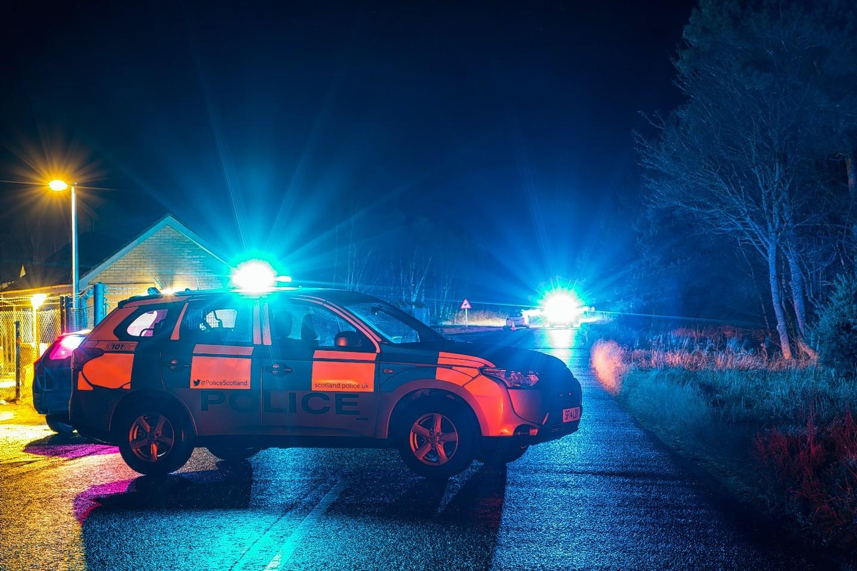 Police at the scene of the crash in Moray