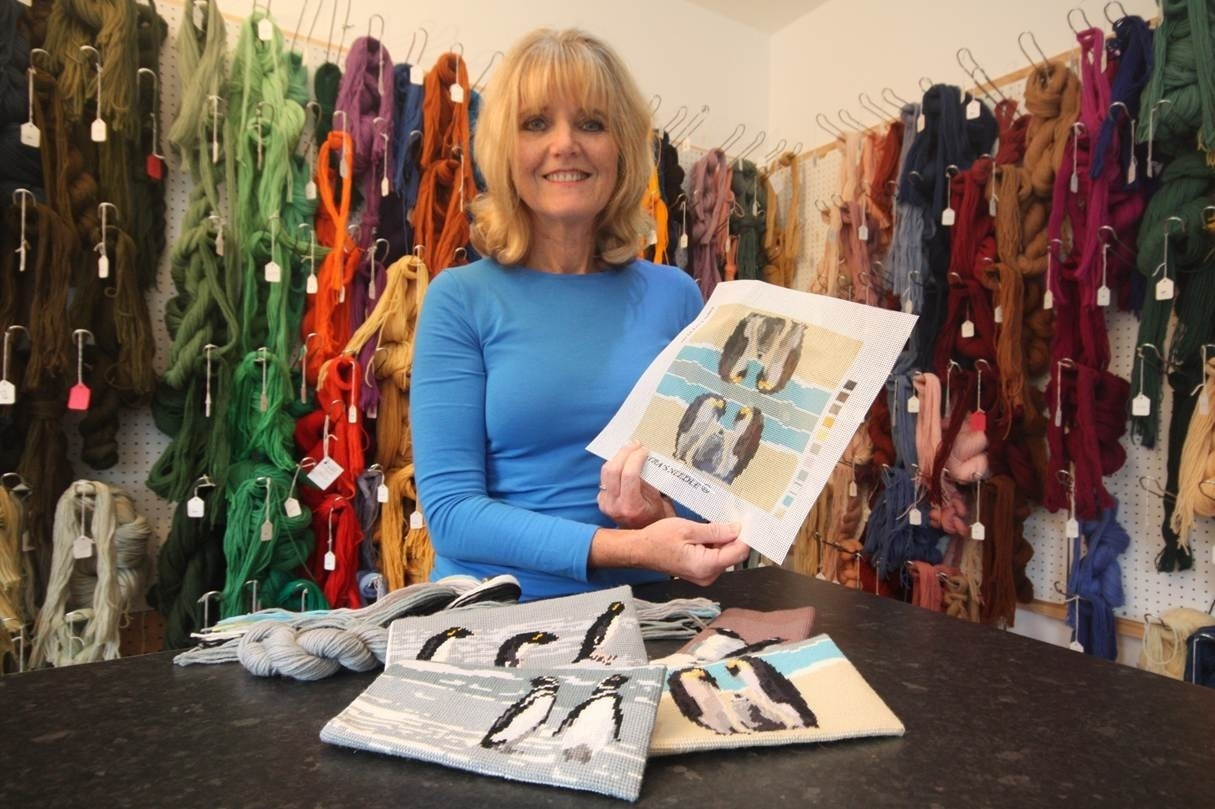 Lyndsay MacEwen  owner of Cleopatra's Needle, shows off Falkland Island Penguin Tapestry Kits
