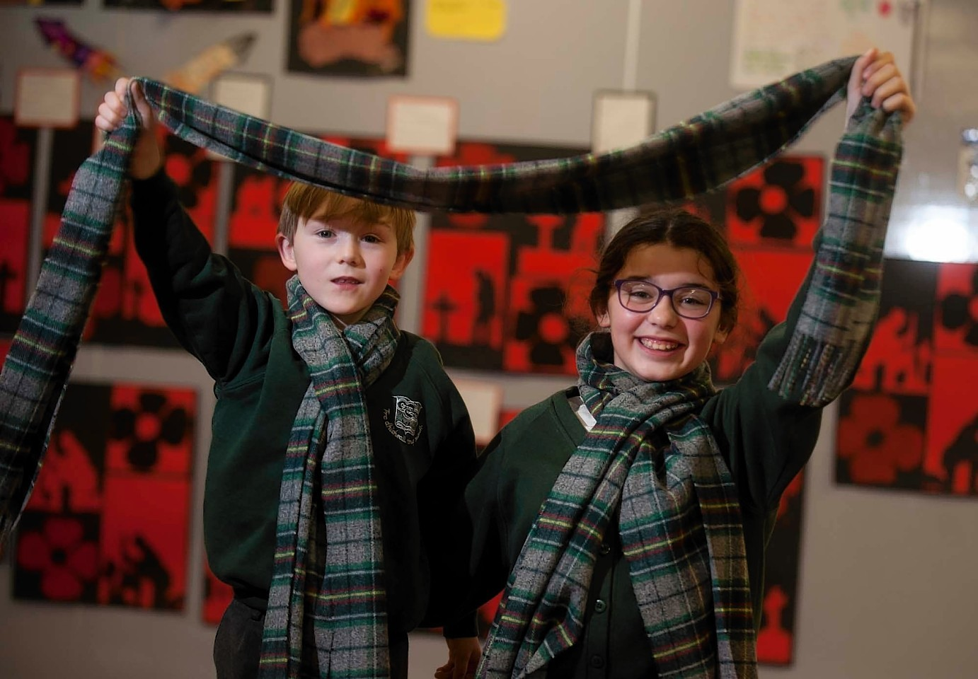 Archie Coull  and Aliyah Wilson with their tartan