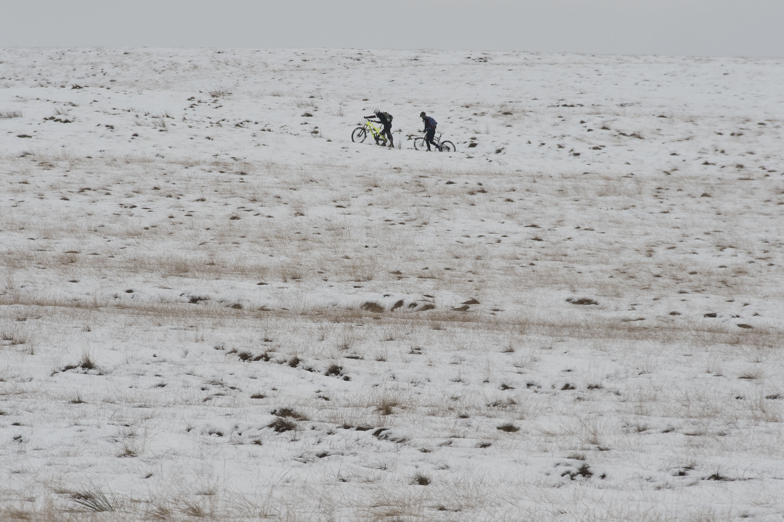 Cyclists push their bikes across Marsden Moor in west Yorkshire,