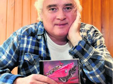 Dougie Burns Singer Inverness Dougie Burns with a copy of his latest CD Pic - Phil Downie