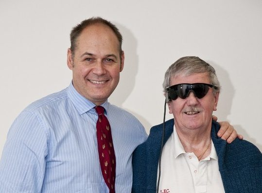Keith Hayman (right), seen here with one of the implanting surgeons Professor Paulo Stanga, was one of the first to have the implant fitted
