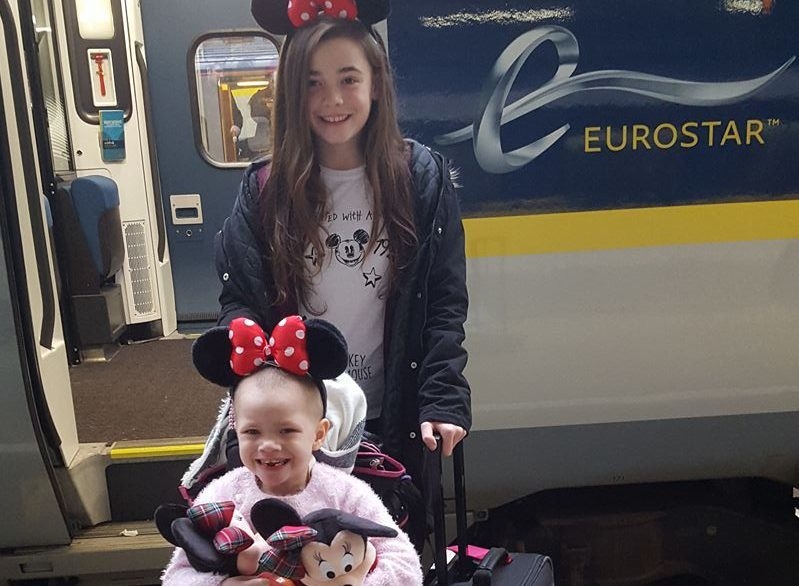 Eileidh Paterson and her sister Cerys wearing Minnie Mouse ears as they set off for Disneyland in France.