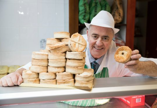 Alistair Bruce with his award winning pies.