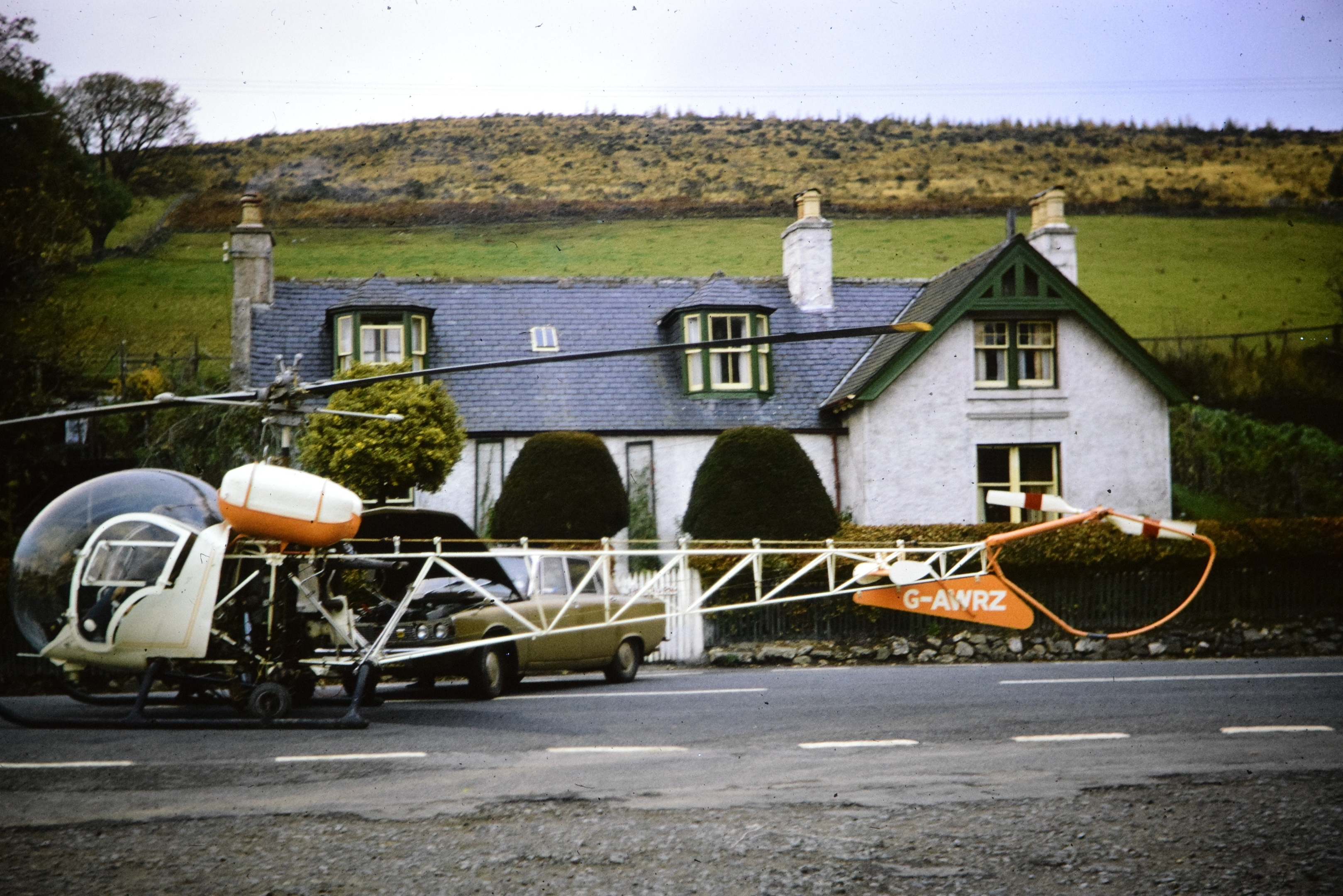 The Bell Type 47G helicopter  being jump started in Bellabeg, Strathdon, 1974.