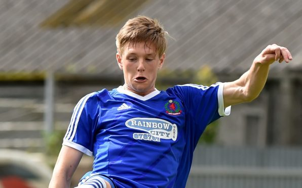 Blair Yule in action for Cove