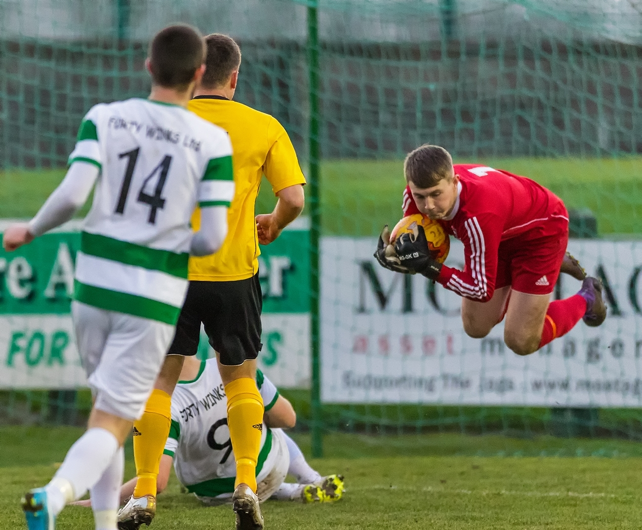 Nairn keeper Dylan MacLean makes a save