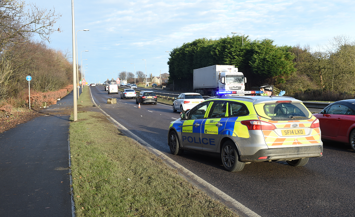Police attend the secen of an accident on the A90  near the AECC Kevin Emslie