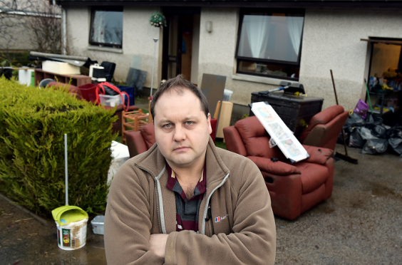 Stuart Moffat, of Canal Crescent Port Elphinstone, at his home shortly after the flood