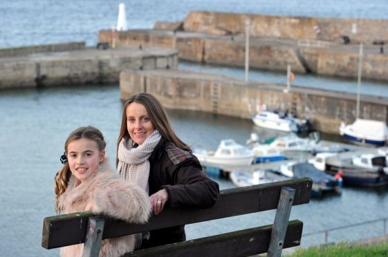 Zara and Marie Gill overlooking Cullen Harbour, which features prominently in their poem.