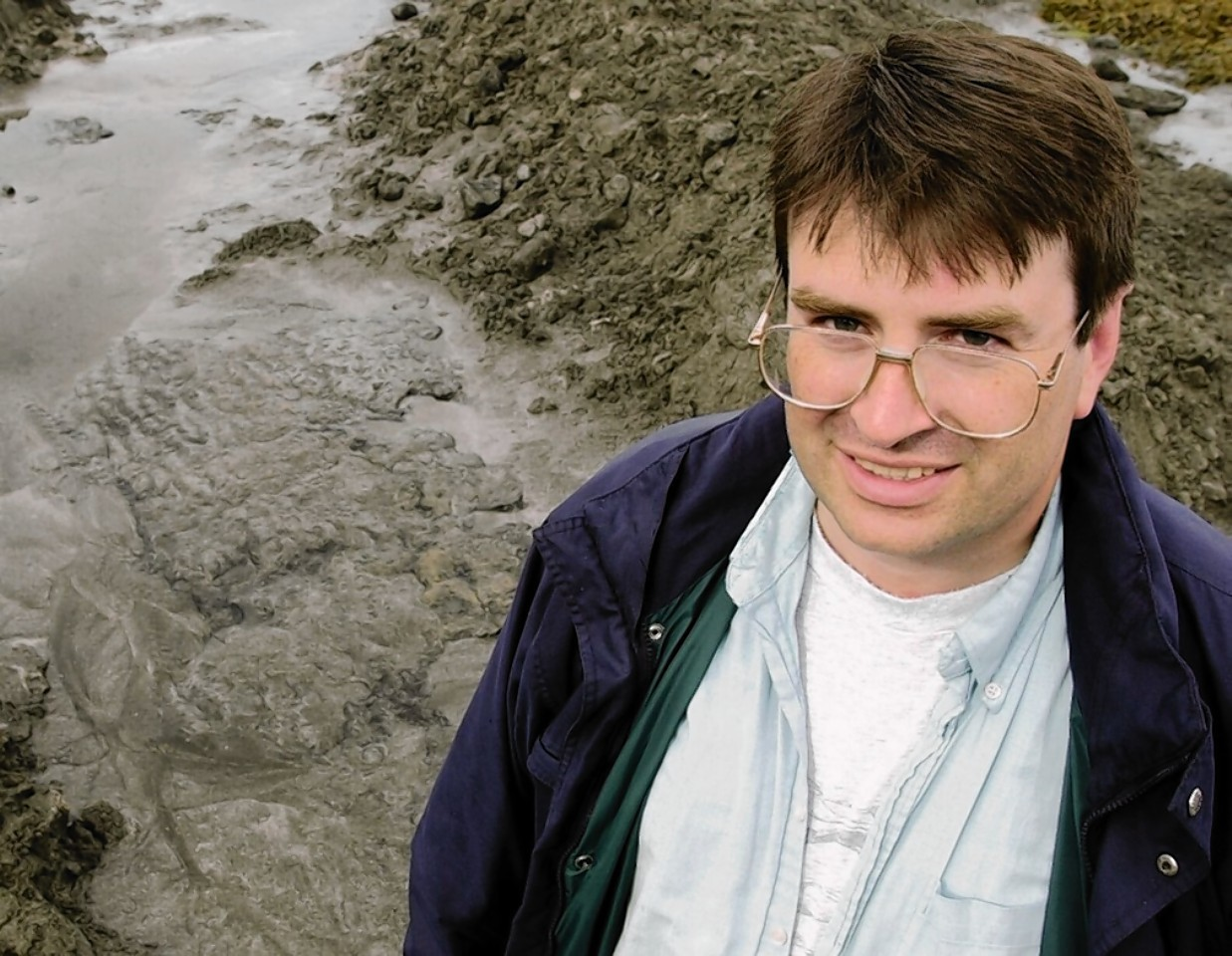 Scientist Neil Clark, pictured in 2002 beside one of the popular dinosaur prints at Staffin on Skye.