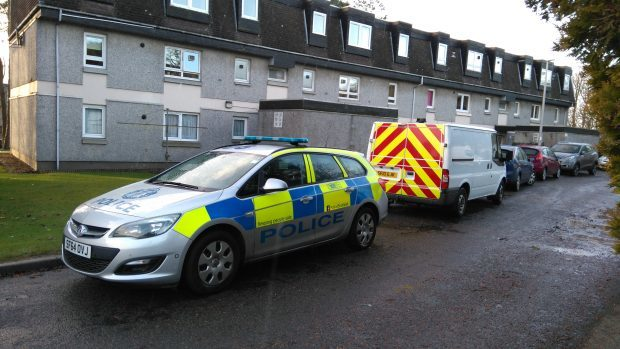 Police at the scene at Johnston Gardens, Culter, yesterday