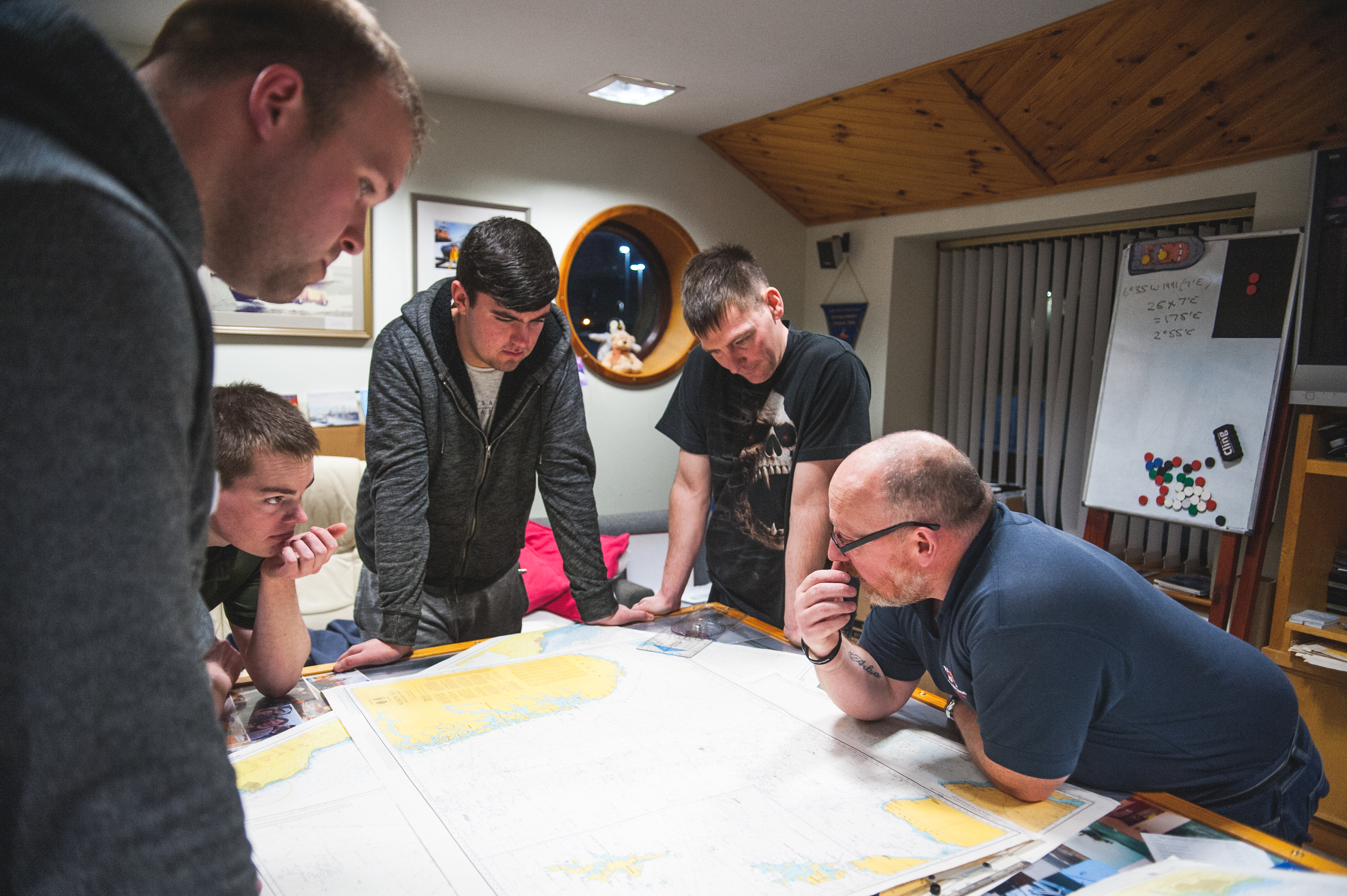 Victor Sutherland, far right, goes through map reading ahead of a launch.