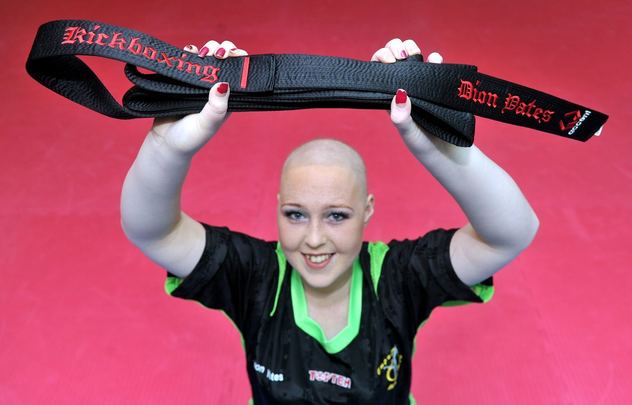 Teenage inspiration, Dion Yates, with the black belt she was awarded by Empower Martial Arts in Lossiemouth, in spite of her continued battle with cancer.