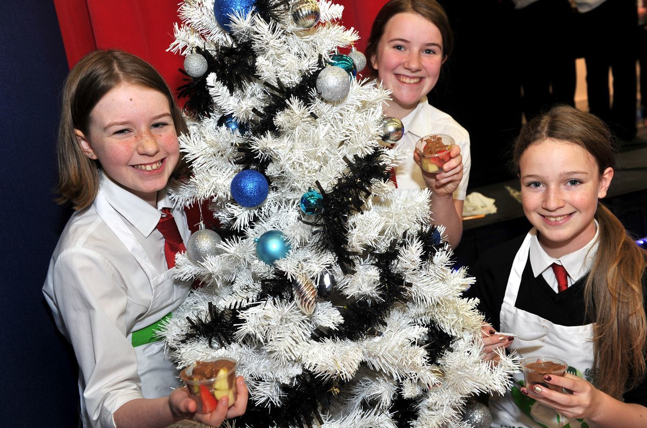 Elgin Academy S2 pupils Rachel Houlding, Moia Cruden, and Millie Beckett sold cocolate-covered fruit cocktail at the market. Picture by Gordon Lennox