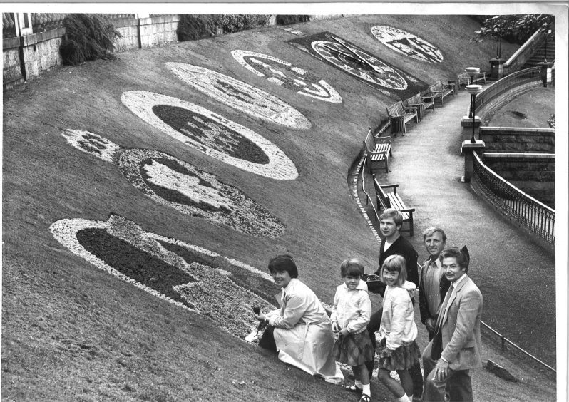 Floral display in 1984 representing the council's stand on nuclear power and women's role in society. In the picture is Councillor Catherine Nikodem and daughters Moira and Marion, and Douglas Stewart, Derek Park and Sandy laird