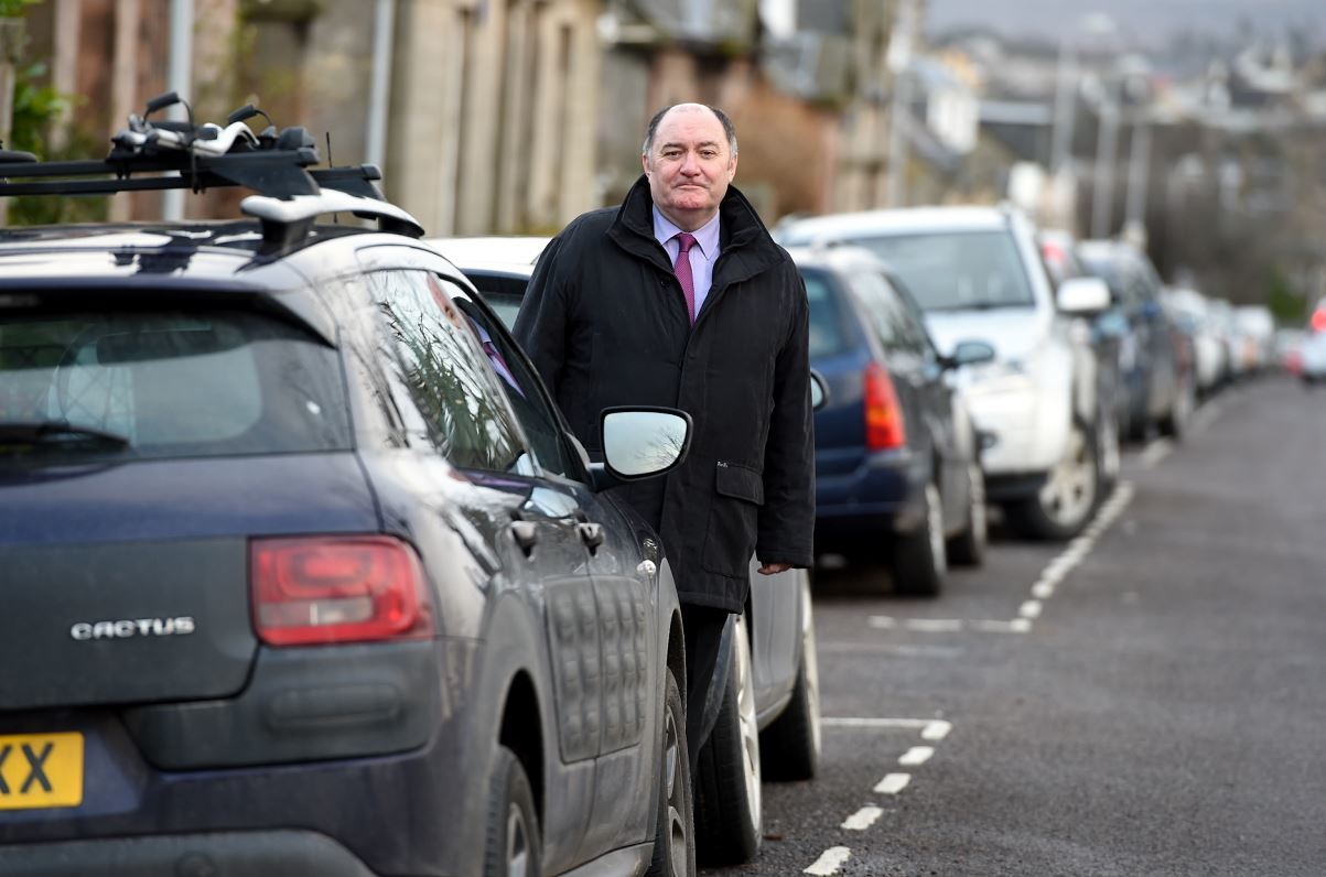 Elgin City South councillor John Divers intends to raise the problem of parking in the town's centre with police.