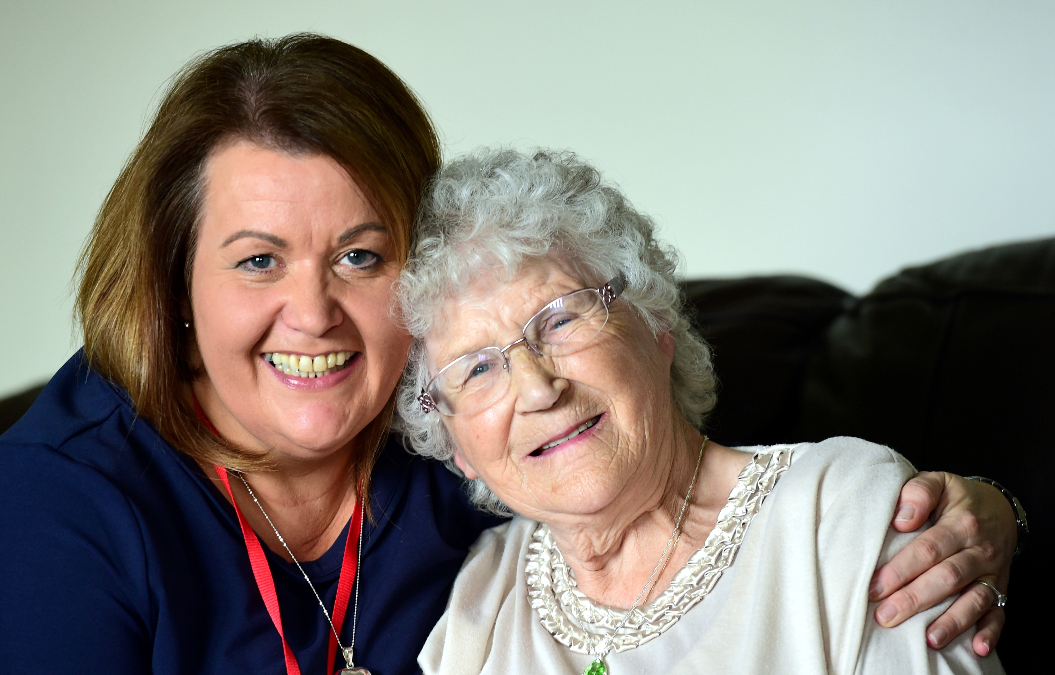 Oil worker Laura Duncan (left) who volunteers for charity TLC who pair up people with the elderly for companionship, she is pictured with her now friend Irene Anderson, who happens to have rescues Laura from a fire 20 years ago. .....see story Kieran Beattie. Picture by Kami Thomson 30-07-16