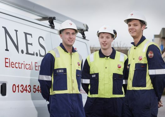 NES electrician Scott Mathieson with apprentices Lewis Bates and Craig Mone.