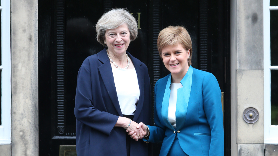 Theresa May, left, and First Minister Nicola Sturgeon