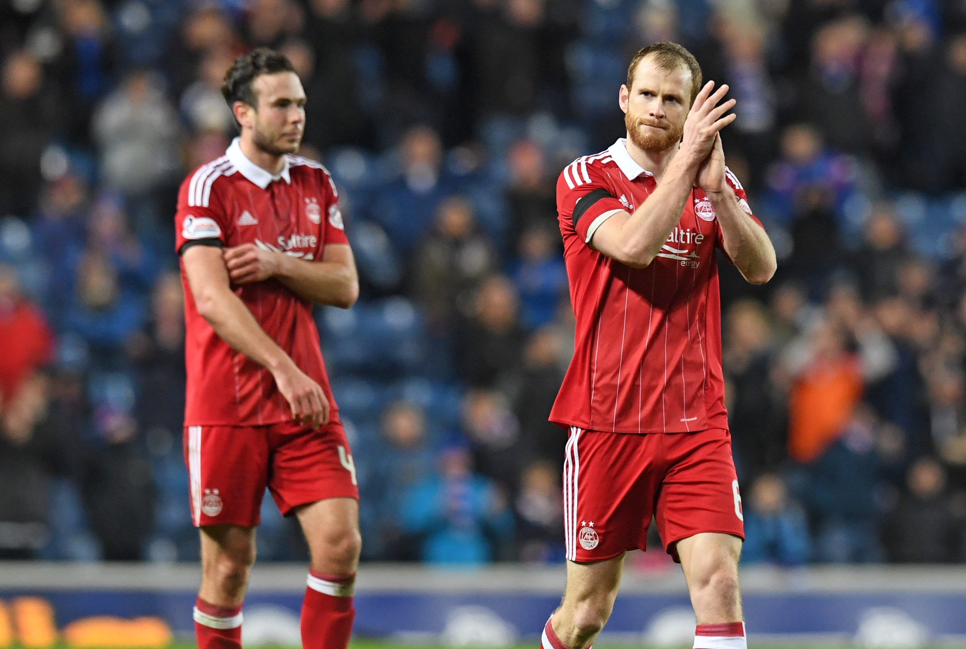 Aberdeen's Mark Reynolds applauded the supporters at full time after Rangers defeat