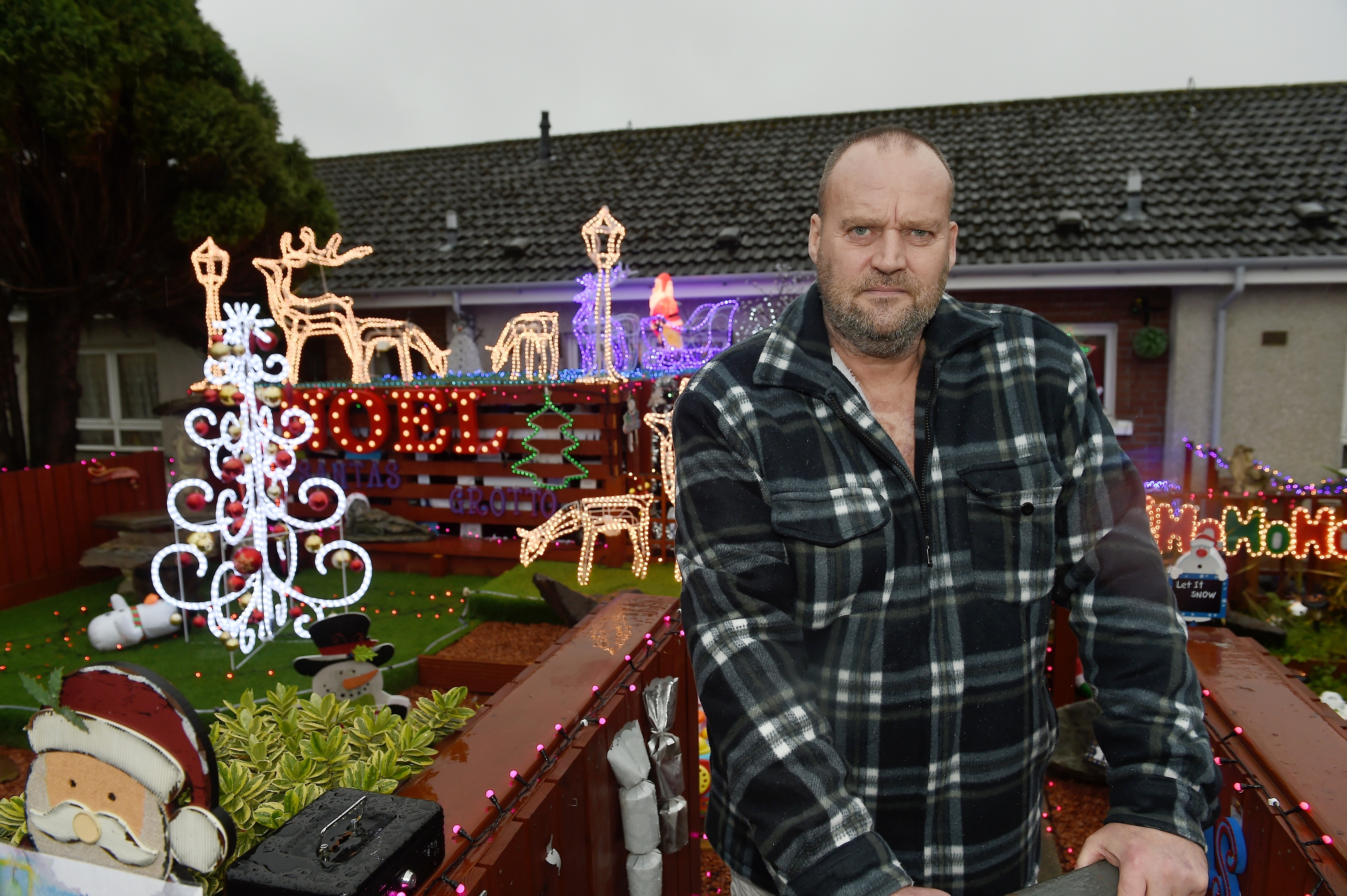 Robert Russell of Oldtown Road, Inverness has had his garden Santas Grotto shut down by Highland Council.