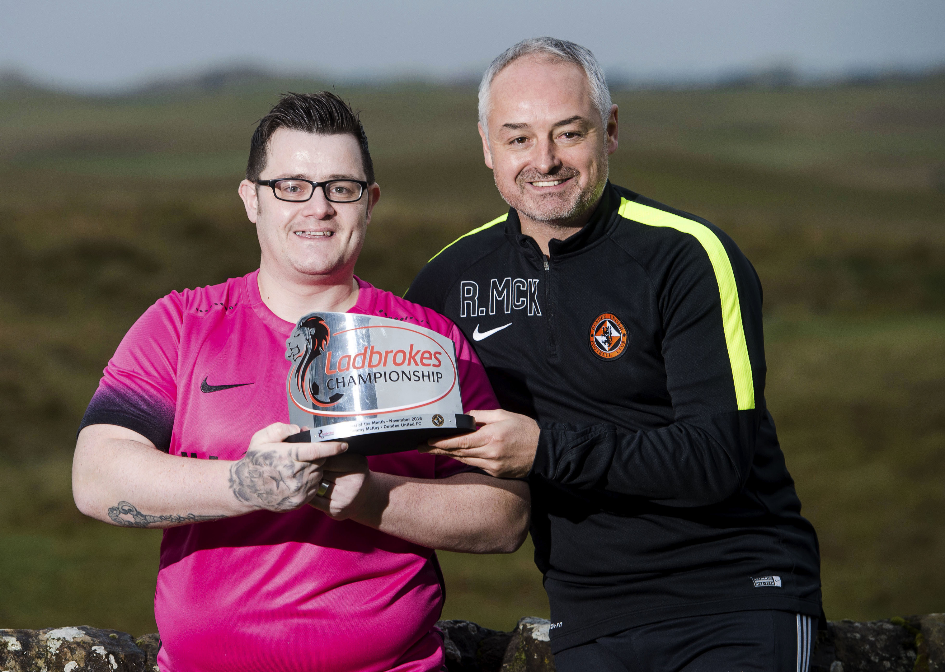 Dundee United supporter Tommy McKay is pictured with Dundee United manager Ray MacKinnon (right) after the fan is awarded the Ladbrokes Championship Goal of the Month award for November
