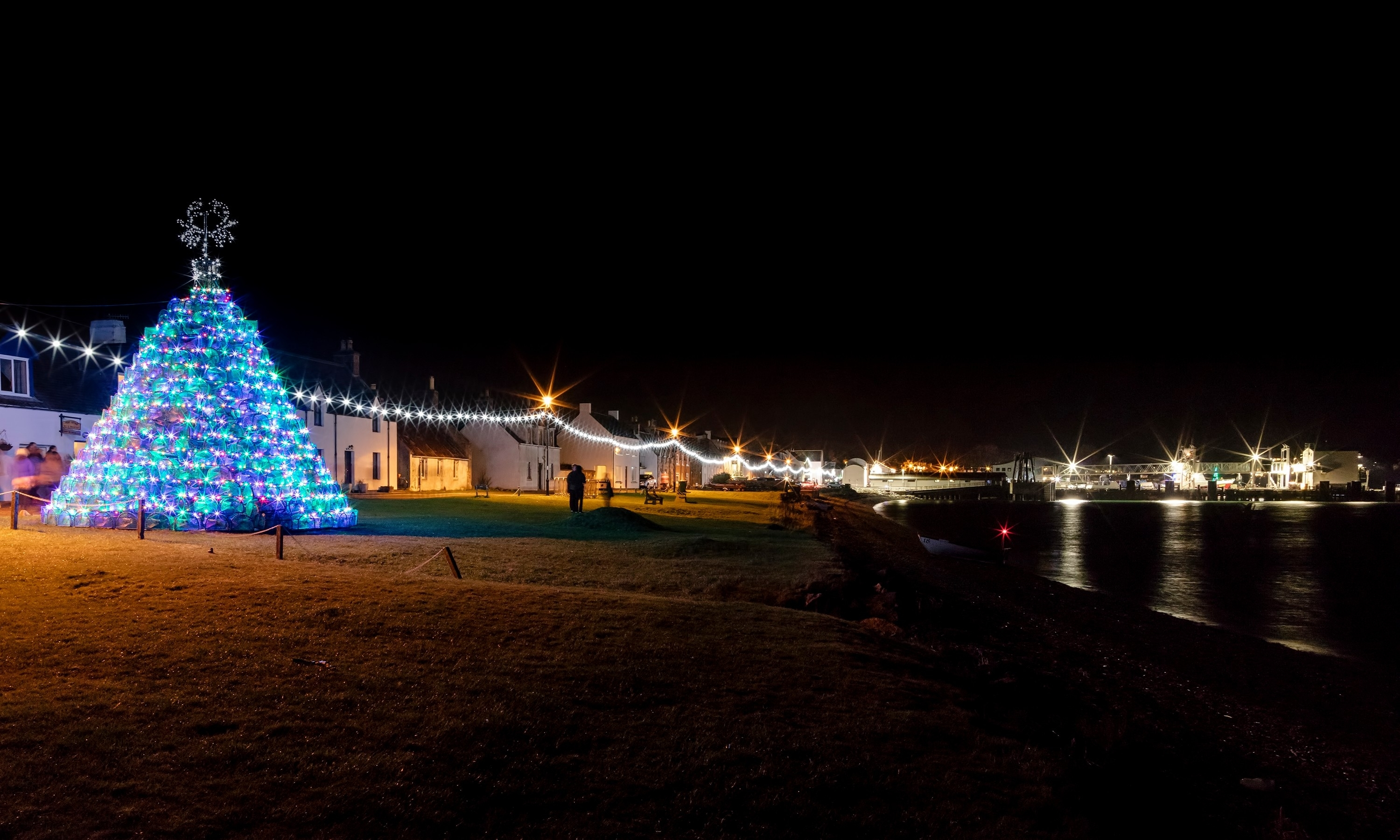 Ullapool Winter Lights Switch On by Steven Gourlay Photography Ltd.