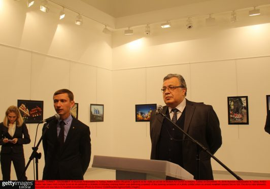 ANKARA, TURKEY - DECEMBER 19: Russian Ambassador to Turkey, Andrei Karlov (R) gives a speech as he visits an art fair at Modern Art Center in Ankara, Turkey on December 19, 2016. Russian Ambassador to Turkey Andrei Karlov has been shot multiple times at an exhibition in Ankara on Monday evening. Karlov was delivering a speech at the opening ceremony of a photo exhibit when an armed assailant opened fire on him. The envoy was seriously wounded and was taken to hospital immediately. (Photo by Ecenur Colak/Anadolu Agency/Getty Images)