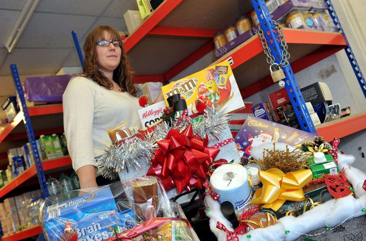 Carrie Marlow, volunteer development officer, at the Moray Foodbank in Elgin with some of the Christmas food parcels being sent out. Picture by Gordon Lennox