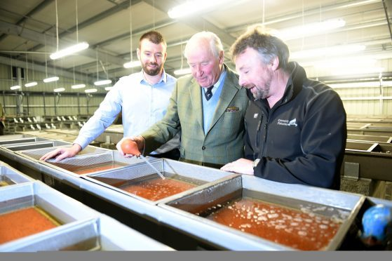 Lord Nickson, (centre) with Michael Jack, Civil Engineer with SSE and Simon McKelvey (right) Director of the Cromarty Firth Fisheries Board in the new facilities.
